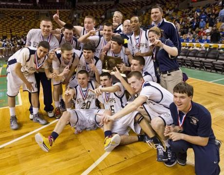 Brendan and Kevin Moran (back row center) and the Spartans celebrate the Division 4 title.